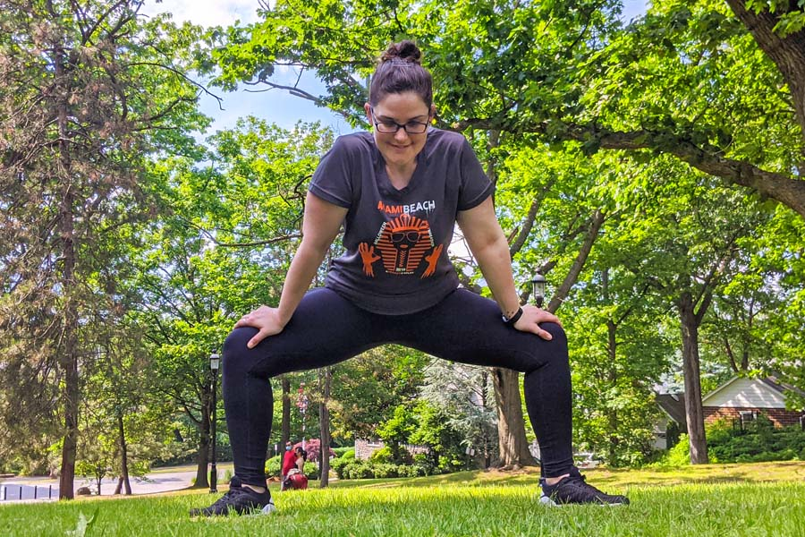 run with amber stretches for runners sumo squat